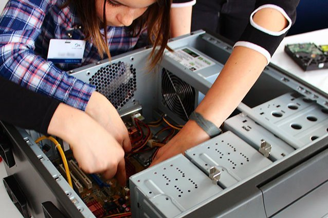 Girls working on a computer case